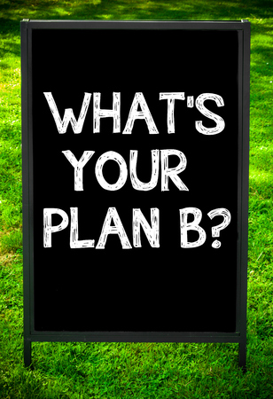 plan b: WHATS YOUR PLAN B?  message on sidewalk blackboard sign against green grass background. Copy Space available. Concept image