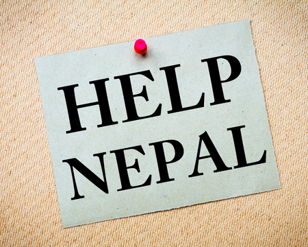 earthquake: HELP NEPAL Note. Recycled paper note pinned on cork board. Concept Image