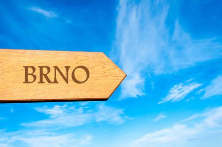 olomouc: Wooden arrow sign pointing destination OLOMOUC, Czech Republic against clear blue sky with copy space available