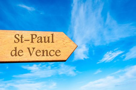 vence: Wooden arrow sign pointing destination StPaul de Vence FRANCE against clear blue sky with copy space available