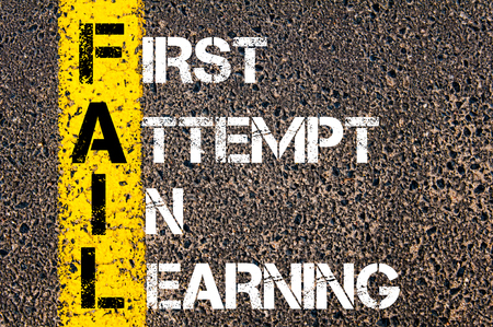 attempt: Business Acronym FAIL as FIRST ATTEMPT IN LEARNING. Yellow paint line on the road against asphalt background