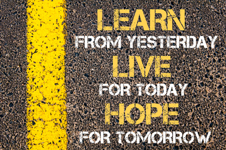tomorrow: Learn from yesterday, live for today, hope for tomorrow motivational quote. Yellow paint line on the road against asphalt background Stock Photo