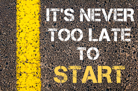 too late: It is never too late to start motivational quote. Yellow paint line on the road against asphalt background