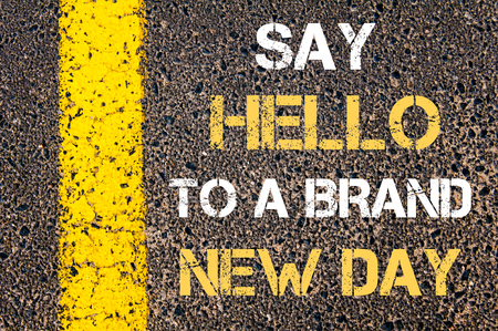 new day: Say Hello to a brand new day motivational quote. Yellow paint line on the road against asphalt background
