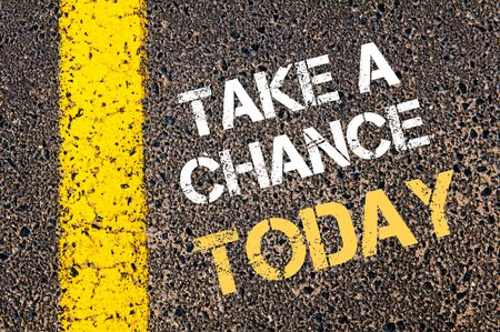 Take a Chance Today motivational quote. Yellow paint line on the road against asphalt background