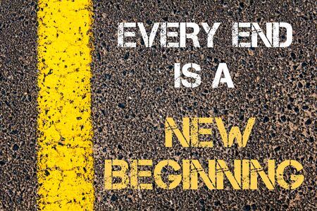 end of the line: Every End is A New Beginning motivational quote. Yellow paint line on the road against asphalt background