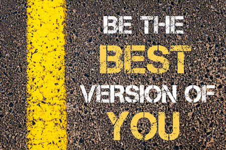 best guide: BE THE BEST VERSION OF YOU motivational quote. Yellow paint line on the road against asphalt background