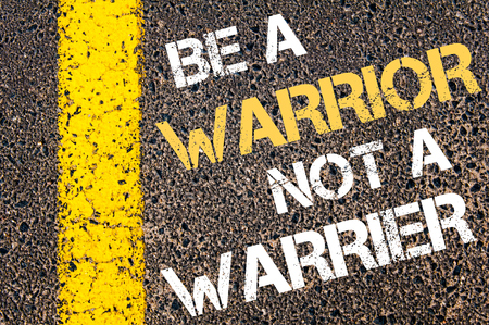 road warrior: BE A WARRIOR NOT A WARRIOR  motivational quote. Yellow paint line on the road against asphalt background