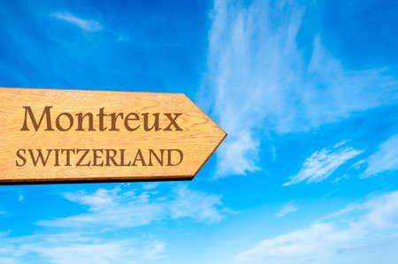 montreux: Wooden arrow sign pointing destination MONTREUX, SWITZERLAND against clear blue sky with copy space available. Travel destination conceptual image Stock Photo
