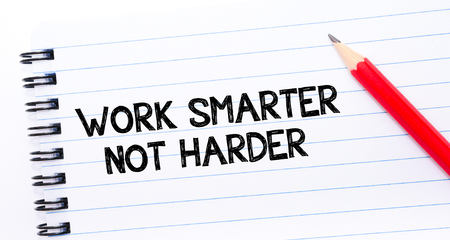 Work Smarter Not Harder Text written on notebook page, red pencil on the right. Concept image Stock Photo