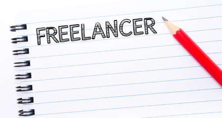 freelancer: FREELANCER Text written on notebook page, red pencil on the right. Concept image