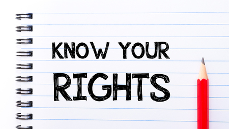 your text: Know Your Rights Text written on notebook page, red pencil on the right