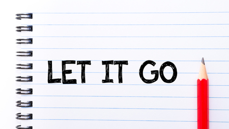 let: Let It Go Text written on notebook page, red pencil on the right Stock Photo
