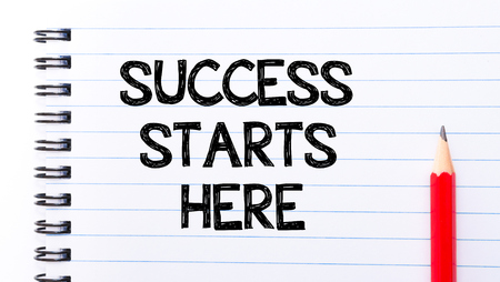 succes: Succes Starts Here Text written on notebook page, red pencil on the right. Motivational Concept image Stock Photo