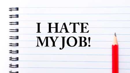 hate: I Hate My Job Text written on notebook page, red pencil on the right