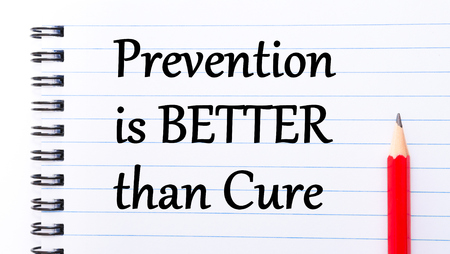 then: Prevention is Better Then Cure Text written on notebook page, red pencil on the right