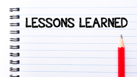 learned: Lessons Learned Text written on notebook page, red pencil on the right