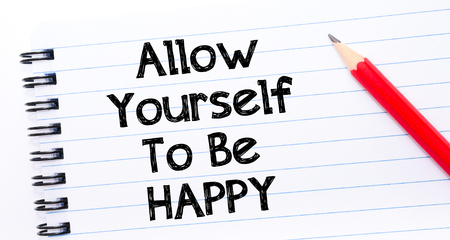 allow: Allow Yourself To Be Happy Text written on notebook page, red pencil on the right