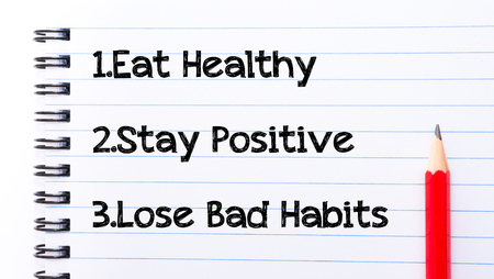 eat right: Eat Healthy, Stay Positive, Lose Bad Habits Text written on notebook page, red pencil on the right