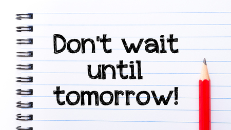 not lined: Do Not Wait Until Tomorrow Text written on notebook page, red pencil on the right.