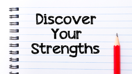 discover: Discover your Strengths Text written on notebook page, red pencil on the right