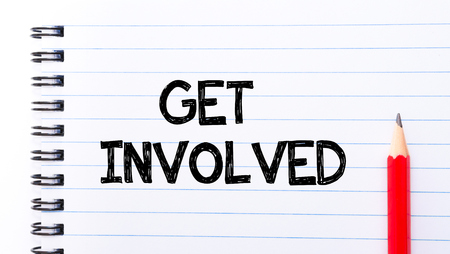 involved: Get Involved Text written on notebook page, red pencil on the right