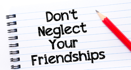 not lined: Do Not Neglect Your Friendships Text written on notebook page, red pencil on the right