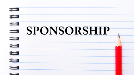 sponsorship: Sponsorship Text written on notebook page, red pencil on the right Stock Photo