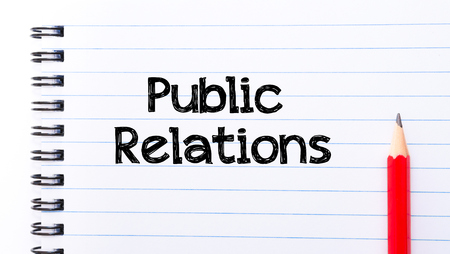 public relations: Public relations Text written on notebook page, red pencil on the right