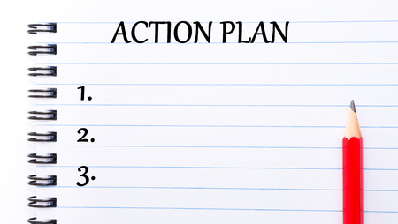 Action Plan Text written on notebook page, red pencil on the right