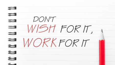 Do Not Wish For It, Work For It Text written on notebook page, red pencil on the right