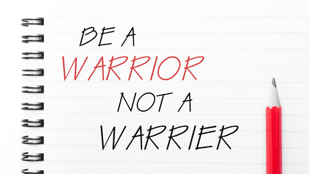 to be or not be: Be A Warrior Not A Warrior Text written on notebook page, red pencil on the right