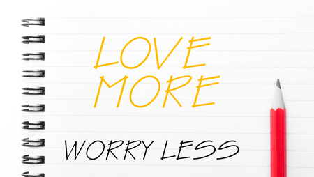 love strategy: Love More Worry Less Text written on notebook page, red pencil on the right Stock Photo