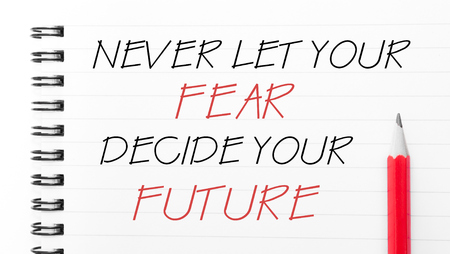 let: Never Let Your Fear Decide Your Future Text written on notebook page, red pencil on the right