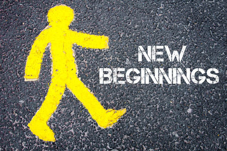 new beginnings: Yellow pedestrian figure on the road walking towards  New Beginnings. Conceptual image with Text message over asphalt background. Stock Photo
