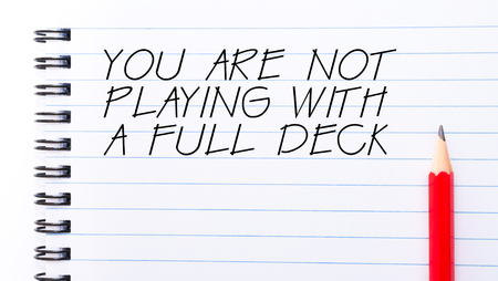 not lined: You Are Not Playing With A Full Deck Text written on notebook page, red pencil on the right Stock Photo