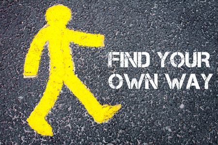 find your way: Yellow pedestrian figure on the road walking towards  FIND YOUR OWN WAY. Conceptual image with Text message over asphalt background. Stock Photo