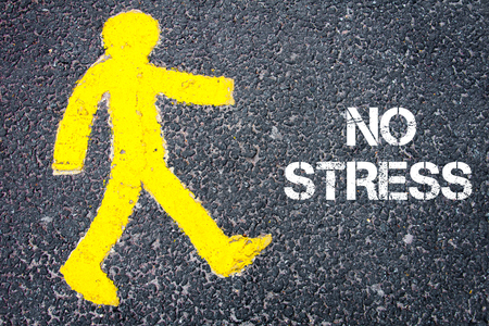 Yellow pedestrian figure on the road walking towards NO STRESS. Conceptual image with Text message over asphalt background.