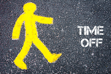 time off: Yellow pedestrian figure on the road walking towards TIME OFF. Conceptual image with Text message over asphalt background.