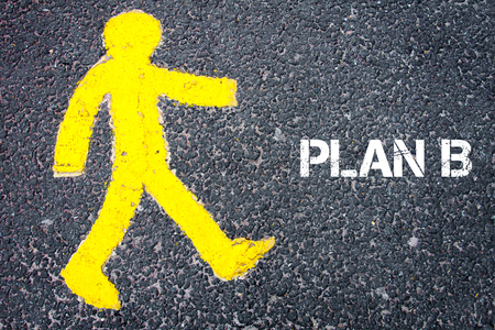 plan b: Yellow pedestrian figure on the road walking towards PLAN B. Conceptual image with Text message over asphalt background.
