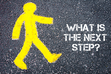 Yellow pedestrian figure on the road walking towards WHAT IS THE NEXT STEP. Conceptual image with Text message over asphalt background.