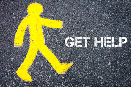 get help: Yellow pedestrian figure on the road walking towards GET HELP. Conceptual image with Text message over asphalt background.