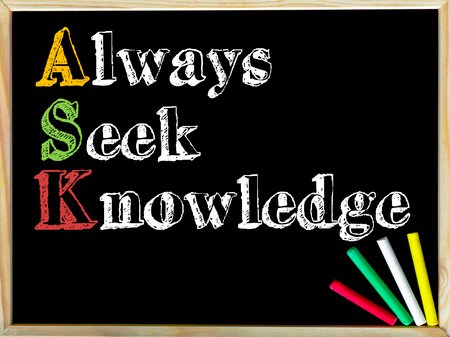 seek: Acronym ASK as ALWAYS SEEK KNOWLEDGE. Written note on wooden frame blackboard, colored chalk in the corner. Motivational Concept image