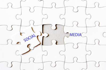 final piece of puzzle: Missing jigsaw puzzle piece completing word SOCIAL MEDIA. Business concept image for completing the final puzzle piece.
