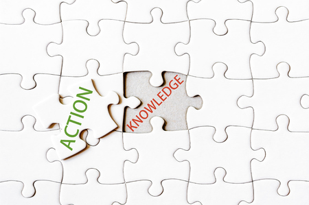 final piece of puzzle: Missing jigsaw puzzle piece with word ACTION, covering text KNOWLEDGE. Business concept image for completing the final puzzle piece.