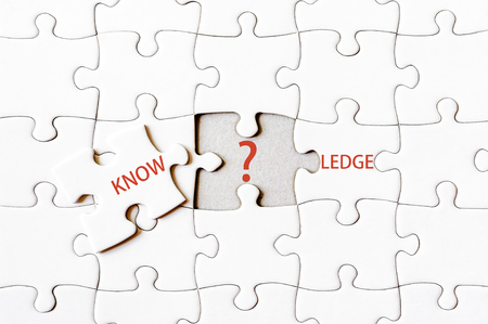 final piece of the puzzle: Missing jigsaw puzzle piece completing word KNOWLEDGE. Business concept image for completing the final puzzle piece.