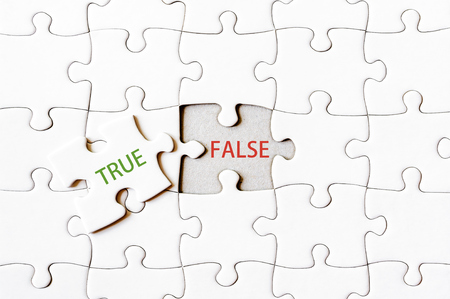 final piece of the puzzle: Missing jigsaw puzzle piece with word TRUE, covering text FALSE. Business concept image for completing the final puzzle piece.