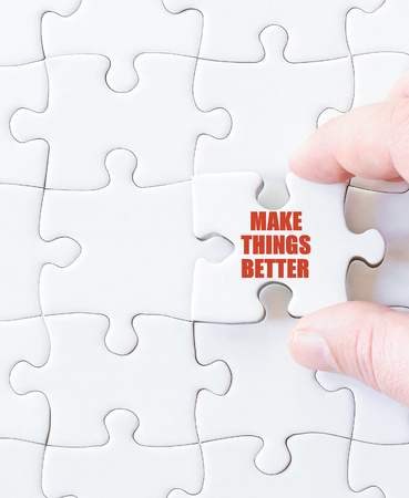 better business: Missing jigsaw puzzle piece with words  MAKE THINGS BETTER. Business concept image for completing the puzzle.