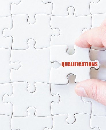 missing link: Missing jigsaw puzzle piece with word  QUALIFICATIONS. Business concept image for completing the puzzle.