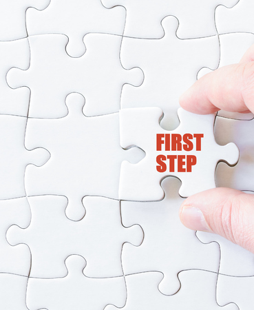 first step: Missing jigsaw puzzle piece with word  FIRST STEP. Business concept image for completing the puzzle. Stock Photo